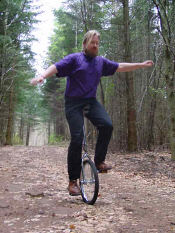 First Bearded Hippy Riding a Unicycle Up Kilimanjaro